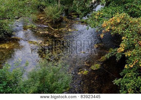 Surface of travertine pond in autumn