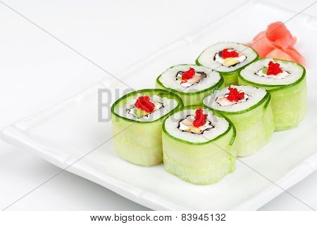 Close-up of Sushi roll with avocado, cucumber and caviar.