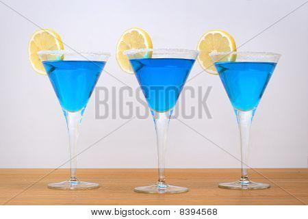 3 blue cocktails