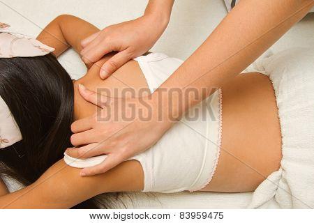 Therapist makes a back massage young children massage