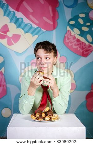 Funny teenage boy eating sweet cakes hungry and candy man poster