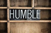 """The word """"HUMBLE"""" written in vintage metal letterpress type in a wooden drawer with dividers. poster"""