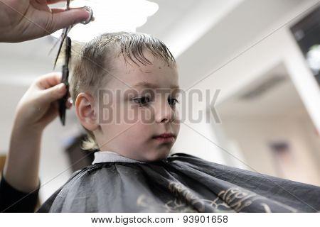 Barber Cutting Hair Of A Kid