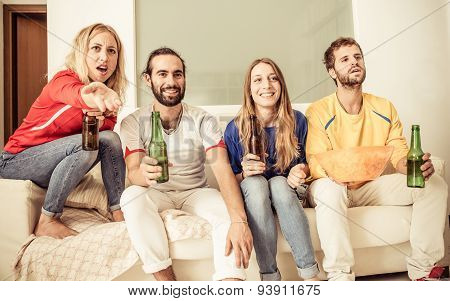 Group Of Friends Watching Sport Match On The Tv