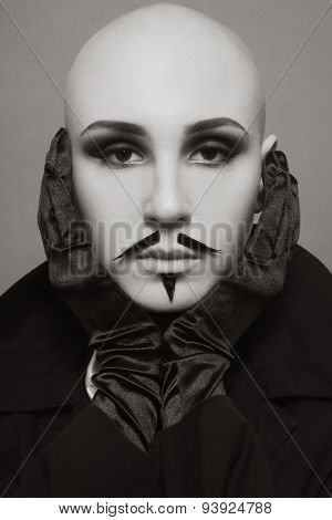 Sepia vintage portrait of skinhead woman with false whiskers and imperial beard