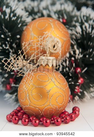 Christmas decoration sitting on small red docorative balls