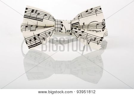 white bow tie with notes on a white background