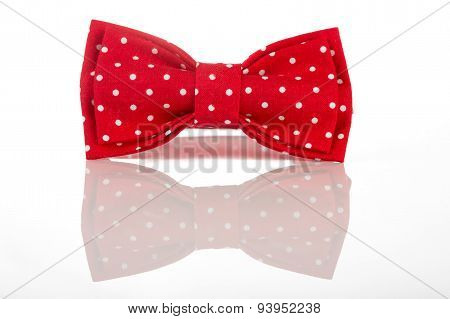 Red bow tie on a white background