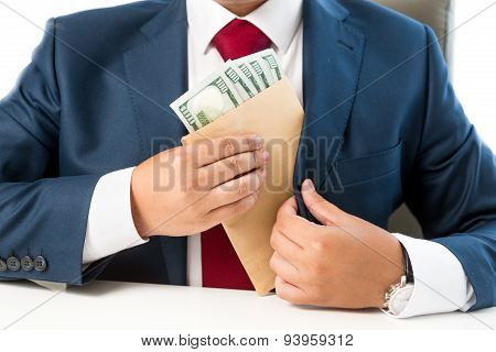 Conceptual Photo Of Bribed Man Putting Money In The Suit Pocket