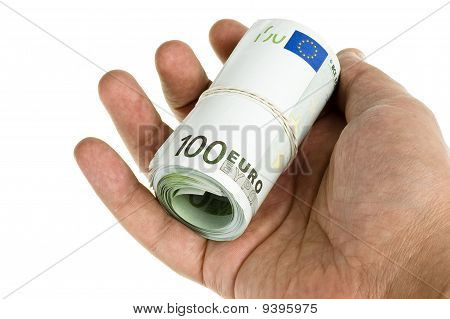 Roll Of Hundred Euro Isolated In Hand