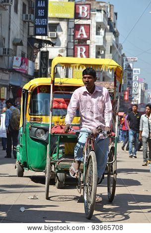 DELHI, INDIA - APRIL 5, 2015: Busy Main Bazar street, the most famous market district of Delhi