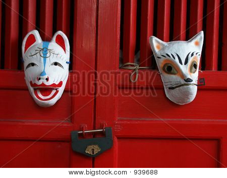 Fox Masks On Red Shrine Doors