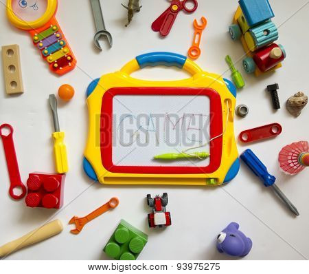 Colorful, Bright, Various Toys Of Rubber And Plastic With A Magic Chalkboard With Place For Your Tex