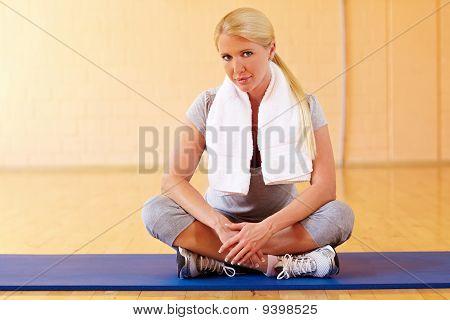 Woman Taking Break In Gym