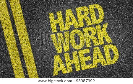 Hard Work Ahead written on the road