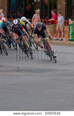 Cyclists Turn Corner At Uptown Criterium