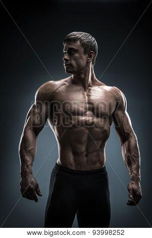Stunning Muscular Young Men Bodybuilder Looking Behind