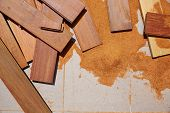 Carpenter sawdust and decking pieces after ipe wood deck work poster