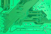a green electronic circuit board close up poster