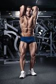 Strong Athletic Man Fitness Model Torso showing muscles in gym poster