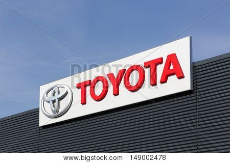 Aarhus, Denmark - September 25, 2016: Toyota logo on a facade. Toyota Motor Corporation is a Japanese automotive manufacturer headquartered in Toyota, Aichi, Japan