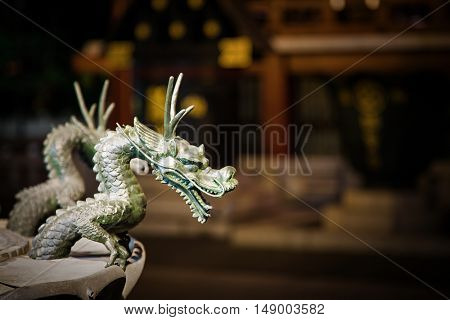 Dragon fountain detail, Sensoji Temple, Tokyo. Space for text.