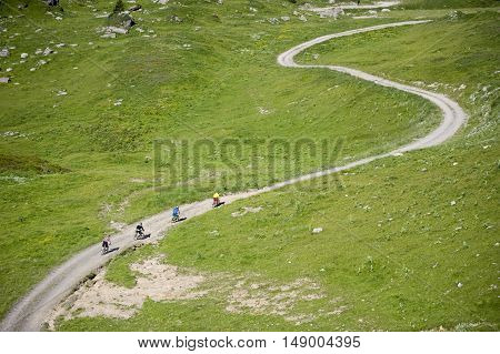 Mountainbikers riding on a path in mountain
