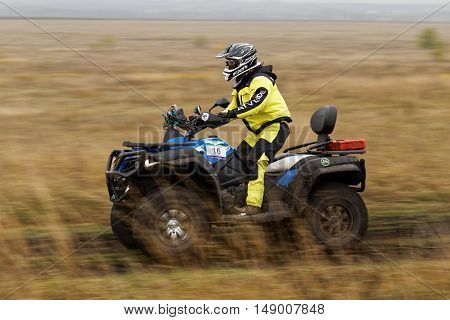 Atv Racer On A Dirt Road Through The Fields.