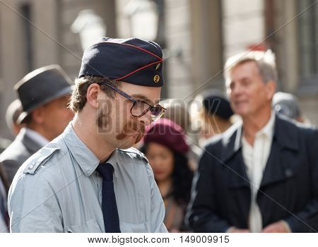 STOCKHOLM - SEPT 24 2016: Man dressed as an postman from 1940 in the Bike in Tweed event September 24 2016 in Stockholm Sweden