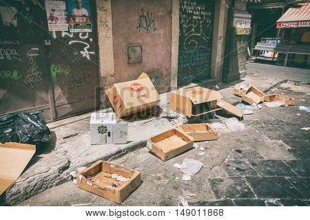 Catania,25 july 2016: Cardboard boxes and other trash littered the streets freely in city of Catania on the island of Sicily - Italy in July 2016
