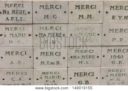 Slates thank Mother Mary and the wall around the Church of the Miraculous Medal in Paris France