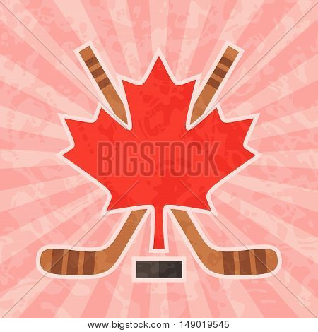 Ice hockey in Canada. Canadian red maple leaf and crossed hockey sticks on vintage and retro background.