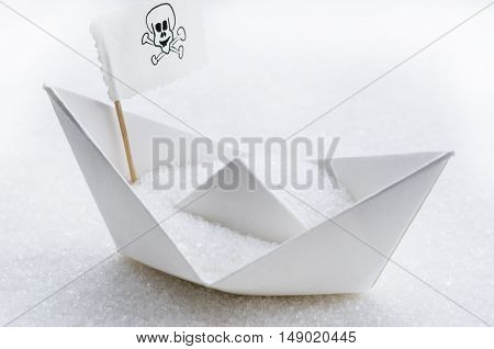 White sugar in a paper boat in a sugar sea