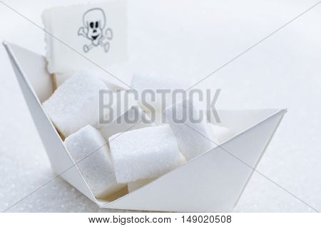 White sugar cubes in a paper boat