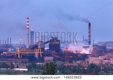 Metallurgical Plant At Night. Steel Factory With Smokestacks