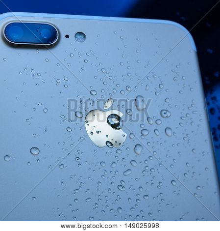 PARIS FRANCE - SEP 26 2016: New Apple iPhone 7 Plus unboxing and testing - drops on apple logo on rear of the phone. New iPhone7 is one of the best waterproof smart phone in the world