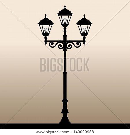 Street light. The black silhouette of a retro lantern. Vector illustration.