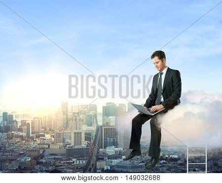 Businessperson on cloud using laptop computer on city background. Cloud computing concept