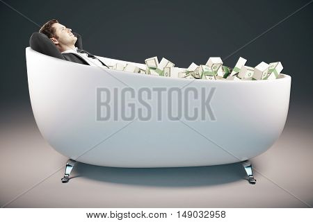 Handsome relaxing businessman lying in bathtub filled with dollar banknote on grey background. Success concept. 3D Rendering