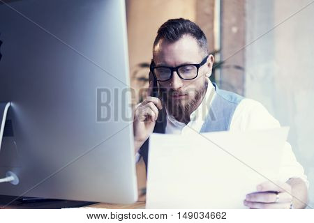 Closeup Bearded Businessman Working Workplace Report.Man Using Smartphone Call Meeting Partner.Young Guy Wearing White Shirt Waistcoat Work Startup Desktop.People Make Great Business Decisions Office