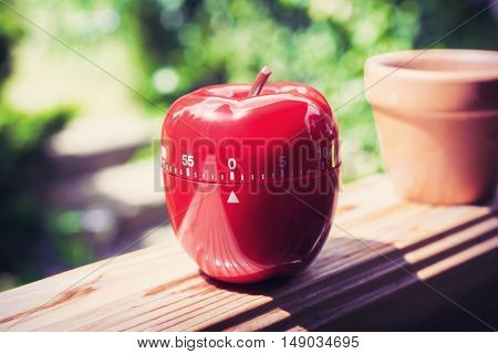 0 Minutes / 1 hour Kitchen Egg Timer in Apple Shape Standing On A Handrail