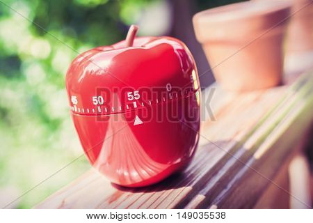 55 Minute Kitchen Egg Timer In Apple Shape Standing On A Handrail