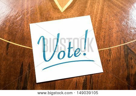 Vote Reminder On Paper Lying On Wooden Cupboard