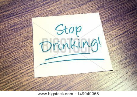 Stop Drinking Reminder On Paper On Wooden Table