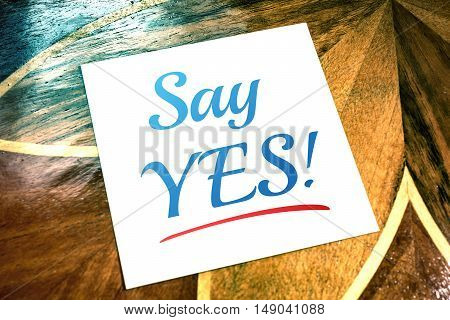 Say Yes Reminder On Paper Lying On Wooden Table