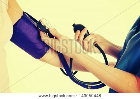 Nurse taking patient blood pressure