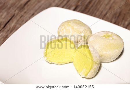 Green tea mochi ice cream bonbon desert on a white plate