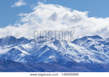 peak of mountain snow with white cloud and blue sky