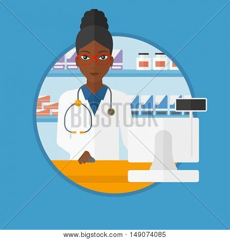 An african-american pharmacist in medical gown standing at pharmacy counter with cash machine. Pharmacist working in the drugstore. Vector flat design illustration in the circle isolated on background