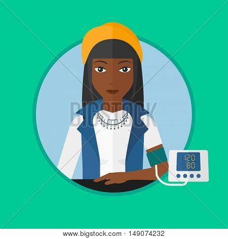 An african-american woman checking his blood pressure with digital blood pressure meter. Young woman measuring blood pressure. Vector flat design illustration in the circle isolated on background.